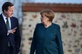 David and Samantha Cameron and their three children, Nancy, Elwen, and Florence visit German Chancellor Angela Merkel and Prof Sauer at Schloss Meseberg to discuss EU reform.